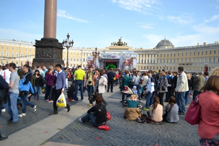 residents: St. Petersburg, Russia - May 9, 2013: Residents of St.Petersburg walk around Palace Square on Victory Day