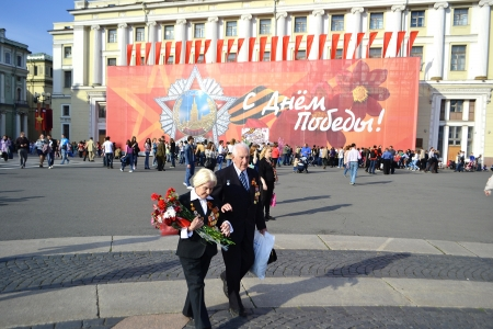 St. Petersburg, Russia - May 9, 2013: Residents of St.Petersburg walk around Palace Square on Victory Day