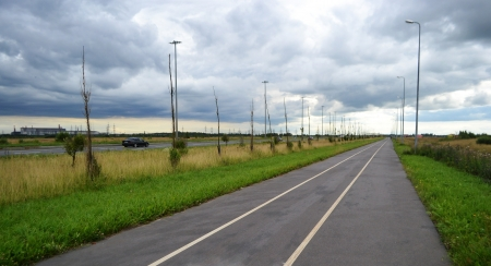 Bike path in the vicinity of St. Petersburg at cloudy day, Russia. photo