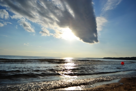 Clouds over sea at sunset, Baltic Sea. photo