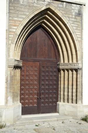 Old door of St  Nicholas Church in Tallinn, Estonia  photo