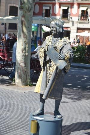 ramblas: Barcelona, Spain - June 22, 2013: Street actor in La Rambla street, Barcelona, Spain.