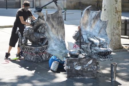 ramblas: Barcelona, Spain - June 22, 2013: Street actor dresses in La Rambla street, Barcelona, Spain.