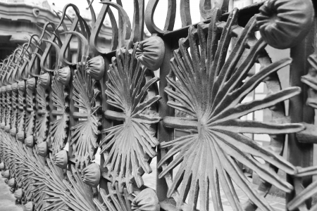 Metal fence designed by Anton Gaudi in Park Guell in Barcelona, Catalonia, Spain. Black and white. photo