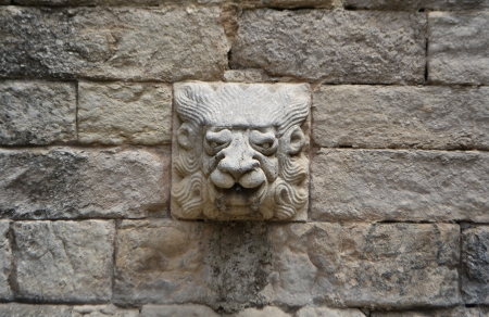 heads old building facade: The fragment of cathedral in Girona, Spain. Stock Photo