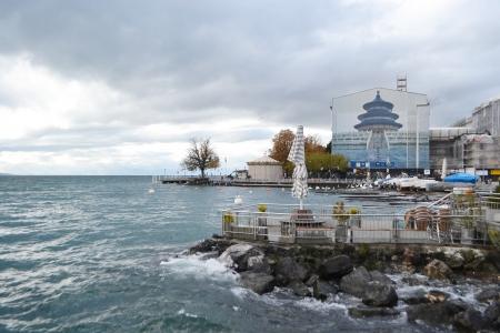 vevey: Vevey, Switzerland - November 6, 2013: Geneva lake and embankment of Vevey, Switzerland. Vevey is a small resort town on the Swiss Riviera.