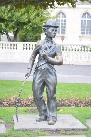 Vevey, Switzerland - November 6, 2013: Charlie Chaplin statue in Vevey, Switzerland. Vevey is a small resort town on the Swiss Riviera.