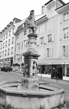 vevey: Vevey, Switzerland - November 6, 2013: Old fountain in Vevey, Switzerland. Black and white.