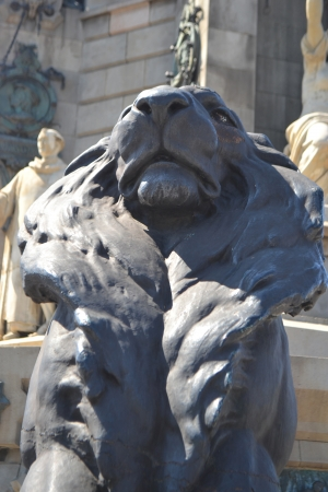Statue of a lion, fragment of Columbus Column in Barcelona, Spain. photo