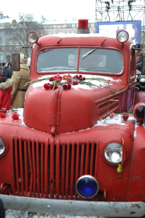 St.Petersburg, Russia - January 26, 2014: Retro fire truck. The Street Life. Cultural project for the 70th anniversary of the liberation of the Nazi blockade of Leningrad on Italian street in St. Petersburg.