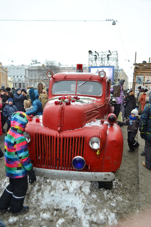 blockade: St.Petersburg, Russia - January 26, 2014: Retro fire truck. The Street Life. Cultural project for the 70th anniversary of the liberation of the Nazi blockade of Leningrad on Italian street in St. Petersburg.