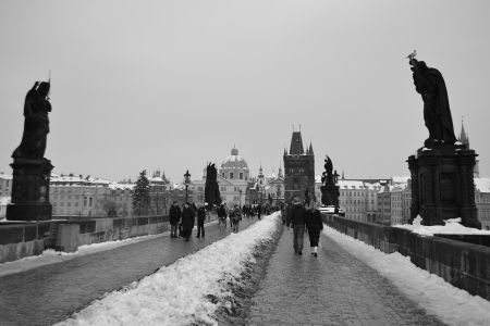 Prague, Czech Republic - February 24, 2013: Ancient Charles Bridge in the center of Prague. Black and white.