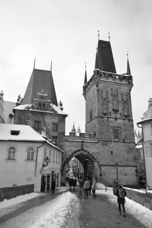 Prague, Czech Republic - February 24, 2013: Tower of ancient Charles Bridge in the center of Prague. Black and white.
