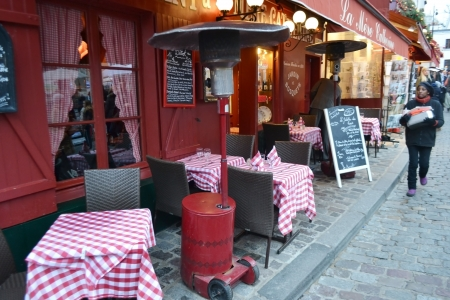 Paris, France - January 6, 2013: Street cafe in the Montmartre district, Paris.