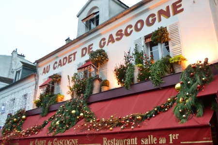 Paris, France - January 6, 2013: Cafe in the Montmartre district, Paris.