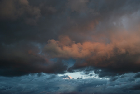 ominous: Dark ominous grey storm clouds at evening. Stock Photo