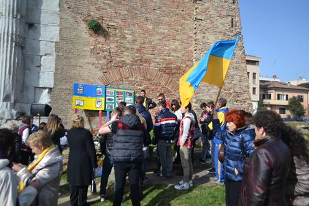 migrant: Rimini, Italy - February 16, 2014: Ukrainian migrant workers rally in support of Kiev Euromaidan in Rimini.