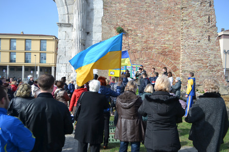 Rimini, Italy - February 16, 2014: Ukrainian migrant workers rally in support of Kiev Euromaidan in Rimini.