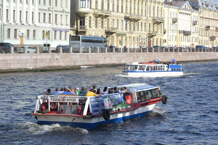 pleasure ship: St.Petersburg, Russia - May 19, 2014: Pleasure ship sails on the river Fontanka in center of St.Petersburg. Editorial