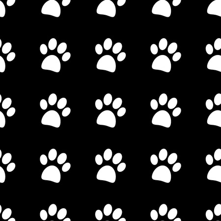 Paw icon seamless vector pattern on black.