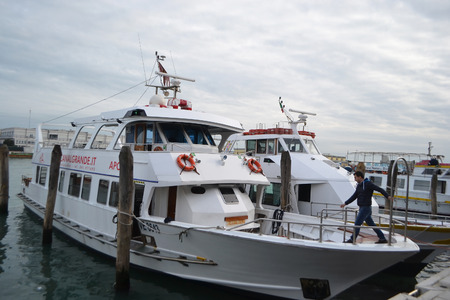 pleasure craft: Venice, Italy - February 18, 2014: Modern passenger pleasure craft in port of Venice.