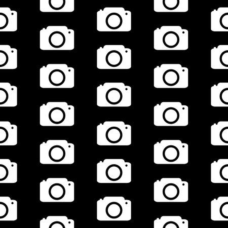 Camera symbol seamless pattern on black background. Vector illustration. Vector