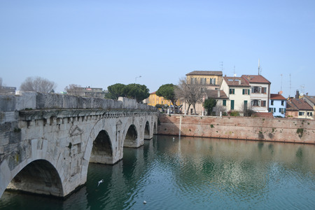 Tiberius bridge over river in Rimini, Italy. photo