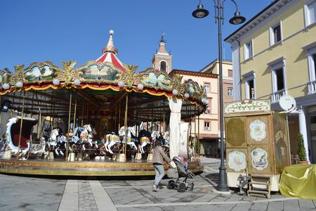 martiri: RIMINI, ITALY - FEBRUARY 21, 2014: Carousel on Piazza Tre Martiri in the historic part of Rimini. Editorial