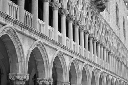 historian: Architectural detail of the Doges Palace (Palazzo Ducale) in Venice, Italy. Black and white. Editorial