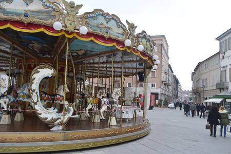 martiri: RIMINI, ITALY - FEBRUARY 19, 2014: Carousel on Piazza Tre Martiri in the historic part of Rimini. Editorial