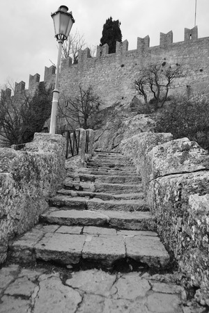 Old stone stairs in San Marino Fortress, Italy. Black and white.