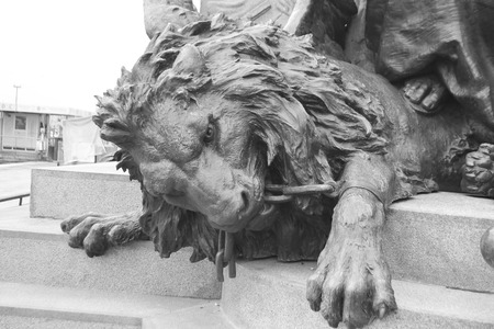 deplorable: Bronze lion statue on the island of San Marco in historic part of Venice, Italy. Black and white.