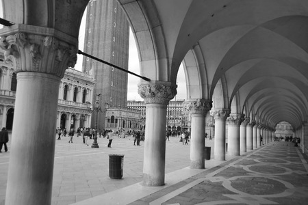 historian: Colonnade of Doges Palace (Palazzo Ducale) in Venice, Italy. Black and white.