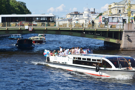 pleasure boat: St.Petersburg, Russia - August 1, 2014: Pleasure boat on the Fontanka River at sunny summer day.