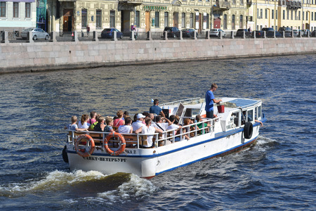 pleasure craft: St.Petersburg, Russia - August 1, 2014: Pleasure boat on the Fontanka River at sunny summer day.