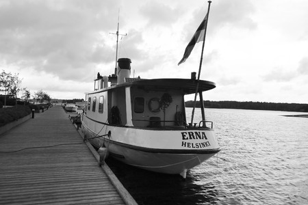 pleasure craft: LAPPEENRANTA, FINLAND - AUGUST 21, 2014: Pleasure craft in Lappeenranta harbor on the Saimaa lake, Finland. Black and white. Editorial