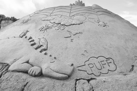 sculptural: LAPPEENRANTA, FINLAND - AUGUST 21, 2014: Sculptural group with dragon. Sand Sculpture Festival in Lappeenranta. Black and white.