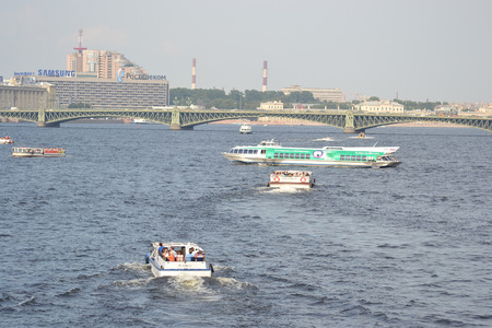 ST.PETERSBURG, RUSSIA - JULY 29, 2014: Pleasure boats on the Neva River in the center of St. Petersburg.
