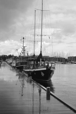 pleasure craft: LAPPEENRANTA, FINLAND - AUGUST 21, 2014: Lappeenranta harbor on the Saimaa lake, Finland. Black and white. Editorial
