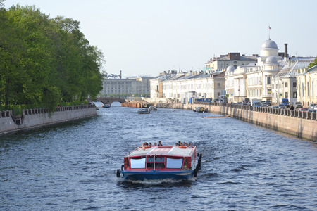 ST.PETERSBURG, RUSSIA - MAY 19, 2014: Pleasure boats on the canal in the center of St. Petersburg.