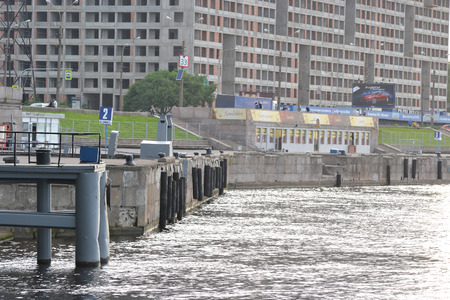 outskirts: ST.PETERSBURG, RUSSIA - JUNE 5, 2014: View of embankment of Neva River, outskirts of St. Petersburg, Russia.