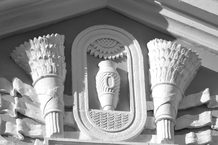 stalin empire style: Bas-relief on building in the style of Stalin in Metallostroy, outskirts of St. Petersburg, Russia. Black and white. Stock Photo