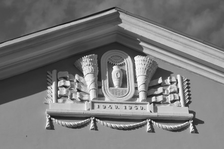 stalin empire style: Bas-relief on building in the style of Stalin in Metallostroy, outskirts of St. Petersburg, Russia. Black and white. Editorial
