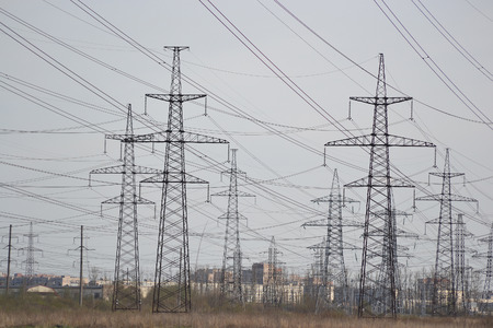 outskirts: Power line at cloudy day, outskirts of St. Petersburg, Russia. Stock Photo