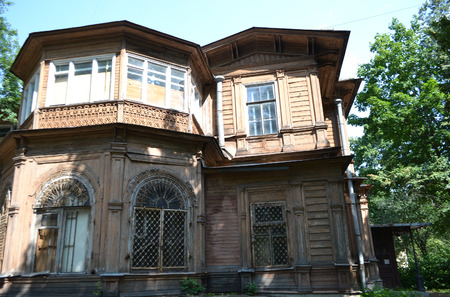 eclecticism: Old wooden abandoned buildind, Manor Gromov, Petrogradskaya side, St.Petersburg, Russia. Stock Photo