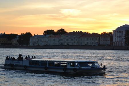 pleasure craft: ST.PETERSBURG, RUSSIA - SEPTEMBER 7, 2013: Pleasure craft on the river Neva at sunset. Editorial
