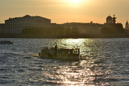 pleasure craft: Pleasure craft on the river Neva at sunset, St Petersburg, Russia.