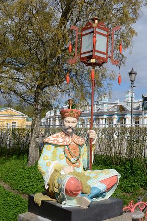 suburb: ST.PETERSBURG, RUSSIA - MAY 13, 2012: Statue of Chinese men in Tsarskoye Selo, suburb of St. Petersburg.