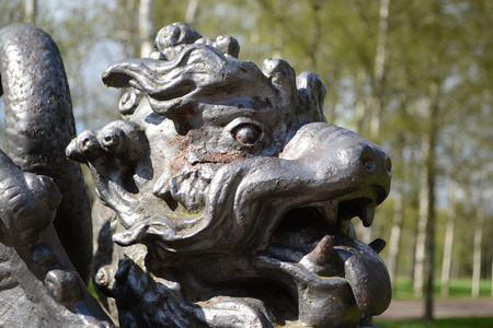 ST.PETERSBURG, RUSSIA - MAY 13, 2012: Metal Chinese Dragon Statue in Tsarskoye Selo, suburb of St. Petersburg.