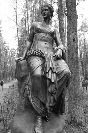 suburb: ST.PETERSBURG, RUSSIA - MAY 13, 2012: Statue of a woman in Pavlovsk park, suburb of St. Petersburg. Black and white.